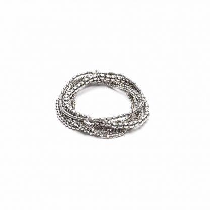 Bracciale elastico 6 fili con forme sferiche miste. Chiusura regolabile con moschettone. Bigiotteria nickel tested.